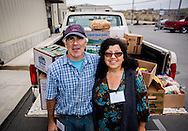 Brother and sister team loading produce for a member agency