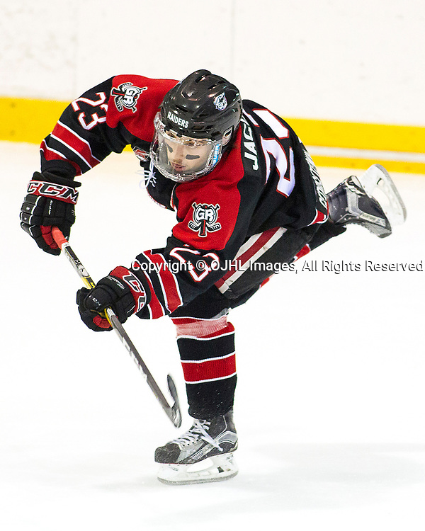 OAKVILLE, ON - APR 4,  2017: Ontario Junior Hockey League, South West Conference Championship game between Georgetown Raiders and the Oakville Blades, Jack Jacome #23 of the Georgetown Raiders passes the puck during the second period.<br /> (Photo by Brian Watts / OJHL Images)
