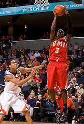 Virginia Military guard Chavis Holmes (3) shoots over Virginia guard Mustapha Farrakhan (2).  The Virginia Cavaliers defeated the Virginia Military Institute Keydets 107-97 in NCAA Basketball at the John Paul Jones Arena on the Grounds of the University of Virginia in Charlottesville, VA on November 16, 2008.
