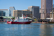 Baltimore, MD, USA --April 13, 2019-- A Baltimore City fireboat  sails into the waters of the inner harbor.