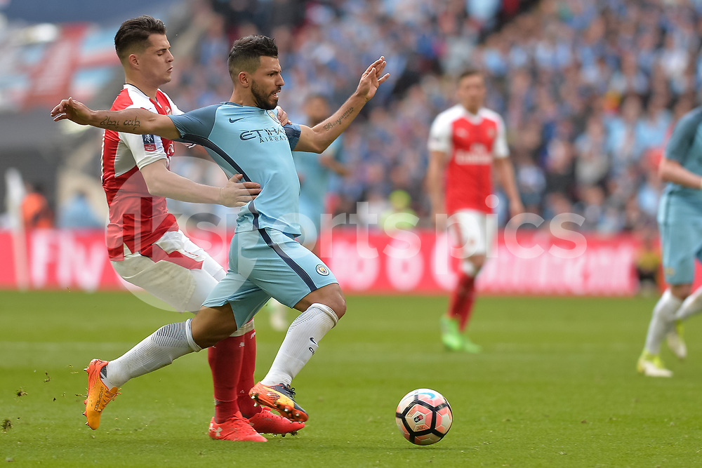 Granit Xhaka of Arsenal challenges Sergio Agüero of Manchester City during the The FA Cup Semi Final match between Arsenal and Manchester City at Wembley Stadium, London, England on 23 April 2017. Photo by Vince Mignott.