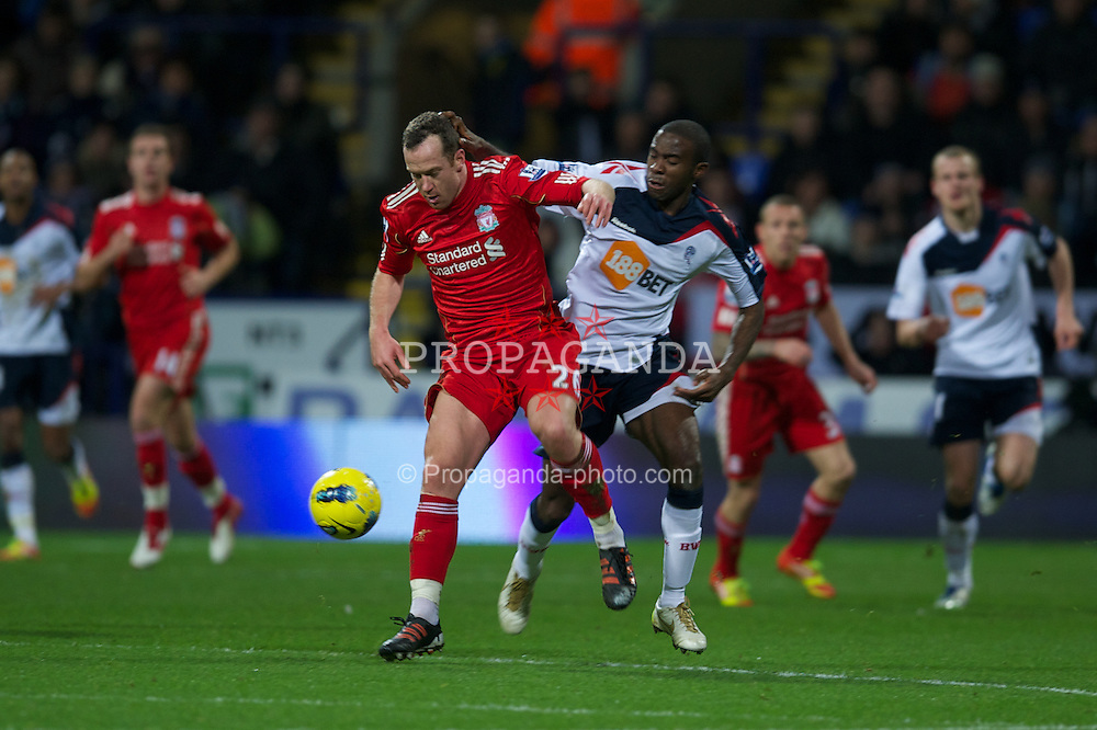 BOLTON, ENGLAND - Saturday, January 21, 2011: Liverpool's Charlie Adam in action against Bolton Wanderers during the Premiership match at the Reebok Stadium. (Pic by David Rawcliffe/Propaganda)