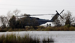 25 Sept, 2005.  Lake calcasieu, Louisiana. Hurricane Rita aftermath. <br /> A military helicopter drops FEMA officials close to the bridge connecting Hackberry one day after the storm.<br /> Photo; &copy;Charlie Varley/varleypix.com