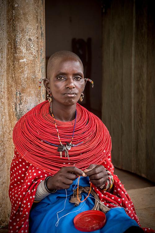 A samburu woman sewing beads