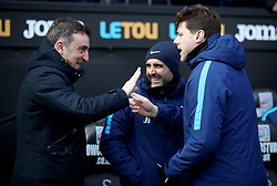 Swansea City manager Carlos Carvalhal (left) and Tottenham Hotspur manager Mauricio Pochettino talk to each other during the Emirates FA Cup, quarter final match at the Liberty Stadium, Swansea.