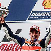Spanish MotoGP rider Marc Marquez of Repsol Honda Team lift the trophy after winning the 2014 Malaysian Motorcycling Grand Prix in Sepang International Circuit near  Kuala Lumpur, Malaysia, 26 October 2014. Marquez winning in 2014 MotoGP Malaysia is the 12th wins of this season, equalling the record held by Mick Doohan.