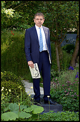 Rowan Atkinson visits the garden called no Man's Land ABF The Soldiers Charity Garden to mark the centenary of World War One on the VIP preview day at the Chelsea Flower Show. London, United Kingdom. Monday, 19th May 2014. Picture by Andrew Parsons / i-Images