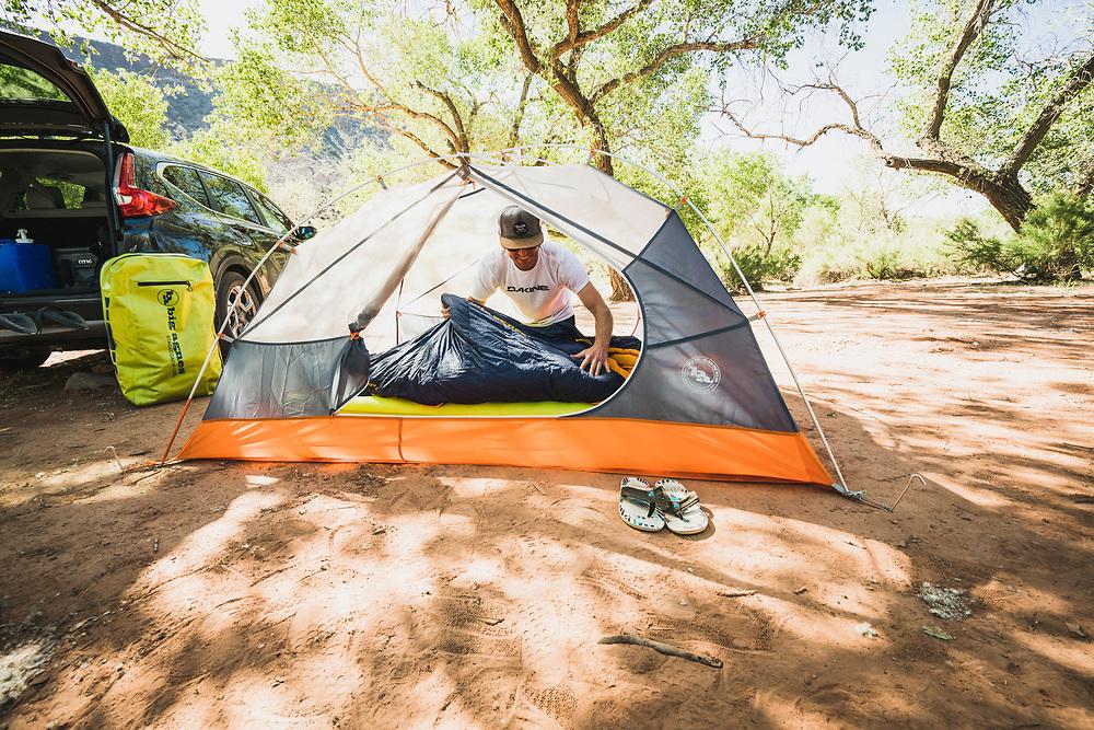 Dane Cronin sets up camp, Virgin, Utah.