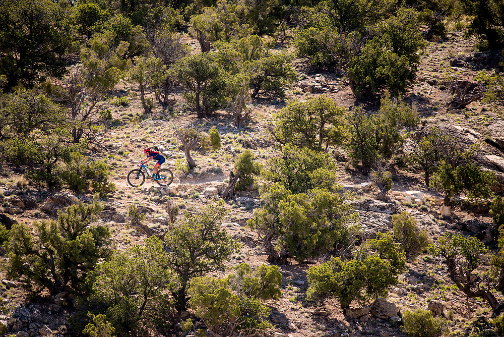 A pro female racer start the descent on Twist-n-Shout trail Sunday.