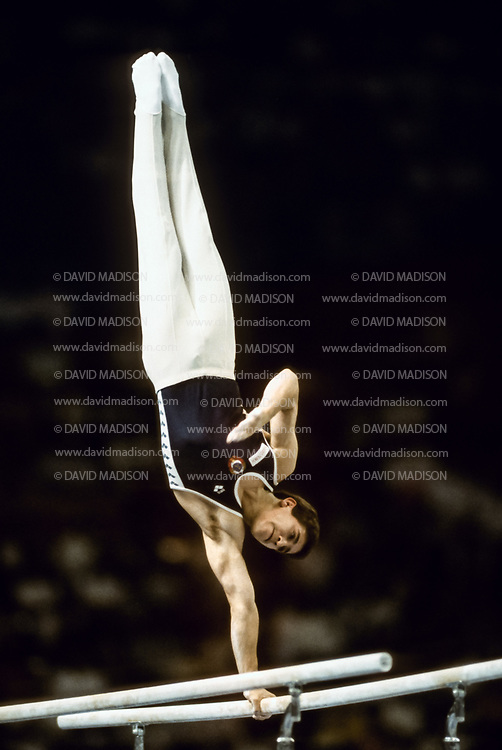 SEATTLE - JULY 1990:  Valerie Belenki of the USSR performs on the parallel bars during the gymnastics competition of the 1990 Goodwill Games held from July 20 - August 5, 1990.  The gymnastics venue was the Tacoma Dome in Tacoma, Washington.  (Photo by David Madison/Getty Images)