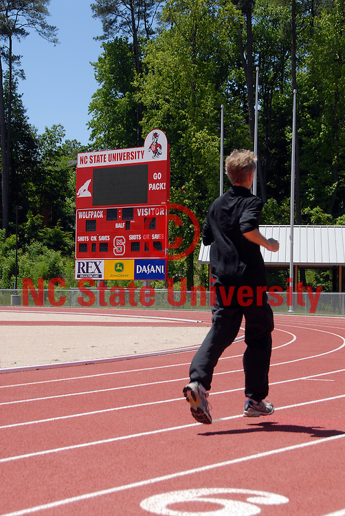 Jogger runs around the Derr Track. PHOTO BY ROGER WINSTEAD