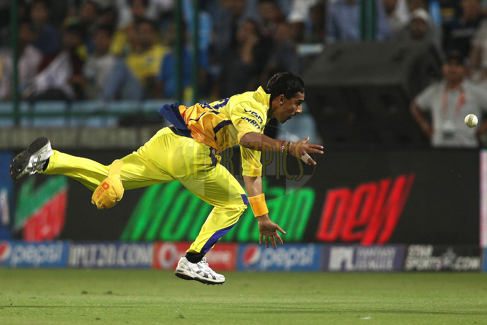 Mithun Manhas of The Chennai Super Kings fails to get to the ball for the catch during match 26 of the Pepsi Indian Premier League Season 2014 between the Delhi Daredevils and the Chennai Super Kings held at the Feroze Shah Kotla cricket stadium, Delhi, India on the 5th May  2014<br /> <br /> Photo by Shaun Roy / IPL / SPORTZPICS<br /> <br /> <br /> <br /> Image use subject to terms and conditions which can be found here:  http://sportzpics.photoshelter.com/gallery/Pepsi-IPL-Image-terms-and-conditions/G00004VW1IVJ.gB0/C0000TScjhBM6ikg
