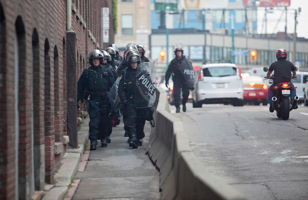 Riot police in Toronto, Canada work into the evening June 26, 2010, to secure the city's downtown core near the G20 summit site. <br /> AFP/GEOFF ROBINS/STR