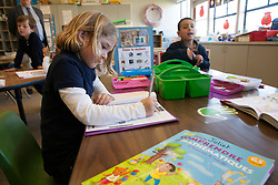 Scenes of  the Santa Rosa French-American Charter School in Santa Rosa,  California .  Students work in class.