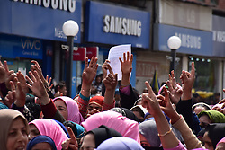 April 17, 2018 - Srinagar, Jammu & Kashmir, India - Anganwadi Workers shouts slogans against the current government during a demonstration in city centre Lal chowk Srinagar against the murder and rape of Asifa..People of Srinagar which includes students of different colleges, locals, traders and Anganwadi Workers, took to the street of city centre Lal chowk Srinagar Summer Capital Of Indian Kashmir during the demonstration against the rape and murder of Asifa Bano. .Asifa Bano, An eight year old girl belonged to a shepherd Bakerwal family. On January 10, she went missing and her body was found a week later laying in the nearby forest of Ranjana In Kathua Jammu. The poor girl was gangraped for seven days in ''Devisithan'' temple in Kathua Jammu. (Credit Image: © Abbas Idrees/SOPA Images via ZUMA Wire)