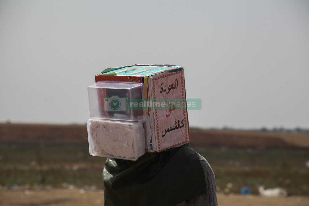 April 13, 2018 - Gaza, Palestine - Palestinians during a protest demanding the right to return to their homeland,third consecutive week, at the Israel border east of Jabalia in the Gaza City, April 13, 2018. (Credit Image: © Ramez Habboub/Pacific Press via ZUMA Wire)