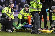 Walsall FC goalkeeper Neil Etheridge covers his face whilst being stretchered off during the The FA Cup fourth round match between Reading and Walsall at the Madejski Stadium, Reading, England on 30 January 2016. Photo by Mark Davies.