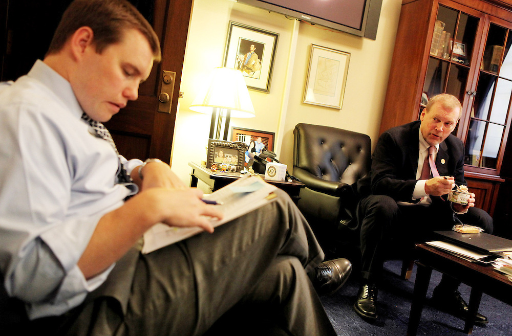 Kyle Green | The Roanoke Times<br /> 10/5/2011 Rep. Morgan Griffith (R-VA) (right), eats canned chicken and crackers during a working lunch with legislative director, Will Hupman in Morgan's office in the Longworth House Office Building in Washington D.C.