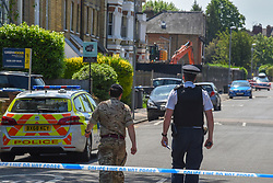 © Licensed to London News Pictures. 23/05/2019. Kingston Upon Thames, UK.  Police and bomb disposal officers extend the corden around a building site in Kingston Upon Thames, UK. Workers have uncovered a WWII unexploded bomb on the former site of the Antionette Hotel.  Photo credit: Stephen Simpson/LNP