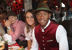 05.10.2014, Theresienwiese, München, GER, 1. FBL, FC Bayern Muenchen am Oktoberfest, im Bild David Alaba (R) of FC Bayern Muenchen and Katja Butylina attend the Oktoberfest 2014 beer festival at Kaefers Wiesenschaenke at Theresienwiese on 2014/10/05. EXPA Pictures © 2014, PhotoCredit: EXPA/ Eibner-Pressefoto/ Pool<br /> <br /> *****ATTENTION - OUT of GER*****