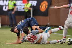 July 28, 2018 - Ann Arbor, MI, U.S. - ANN ARBOR, MI - JULY 28: Liverpool Midfielder Pedro Chirivella (68) slide tackles Manchester United Defender Matteo Darmian (36) in the second half of the ICC soccer match between Manchester United FC and Liverpool FC on July 28, 2018 at Michigan Stadium in Ann Arbor, MI (Photo by Allan Dranberg/Icon Sportswire) (Credit Image: © Allan Dranberg/Icon SMI via ZUMA Press)