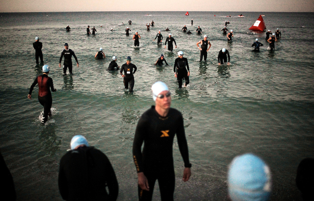 Greg Kahn/Staff.Participants get acclimated to the water before the start of the inaugural HITS Triathlon and Half Triathlon Series held in North Naples on Jan. 8, 2012.