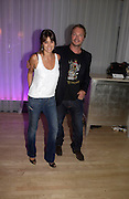 Caroline Acosta and Pete Tong. An evening in aid of cancer charity Clic Sargent held at the Sanderson Hotel, Berners Street, London on 4th July 2005ONE TIME USE ONLY - DO NOT ARCHIVE  © Copyright Photograph by Dafydd Jones 66 Stockwell Park Rd. London SW9 0DA Tel 020 7733 0108 www.dafjones.com