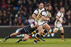 Wasps' Matt Mullan is tackled by Sale's Mark Jennings during the Aviva Premiership match at the AJ Bell Stadium, Sale.