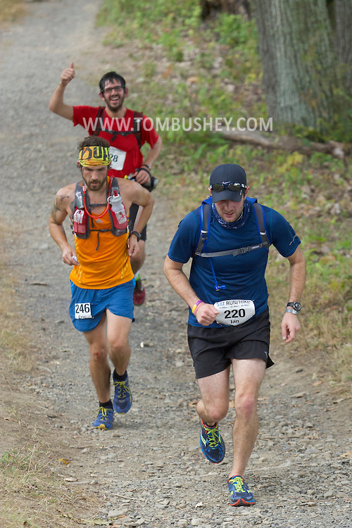 New Paltz, New York - Ian Schwartz leads a group of runners through the Mohonk Preserve during the Shawangunk Ridge Trail Run/Hike 20-mile race on Sept. 20, 2014.