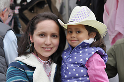 Abby Acosta, 3, got a new hat for the rodeo from her mother Janie on Friday night at the 2013 California Rodeo Salinas.