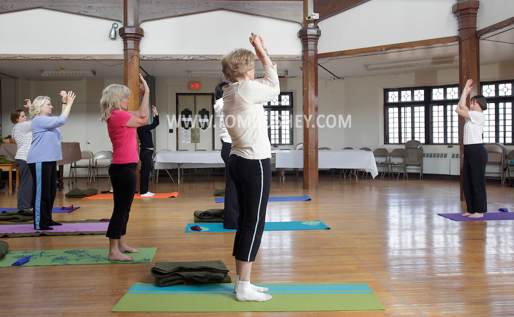 Middletown, New York - Instructor Maria Blon, at right,  of Create Your Wellness leads a yoga class at the First Presbyterian Church on April 21, 2011.