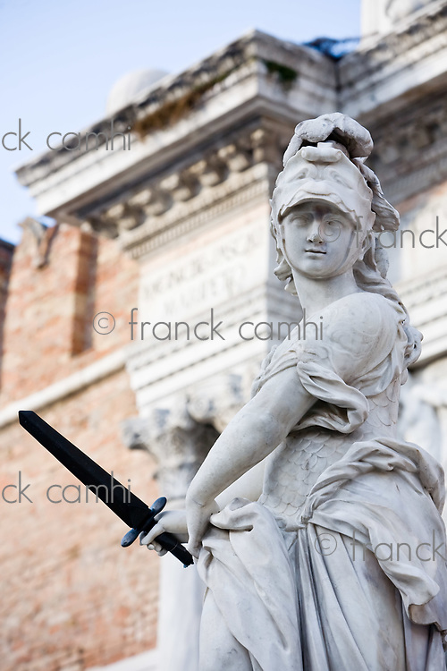 statue of helmeted pallas athena minerva in the beautiful city of venice in italy