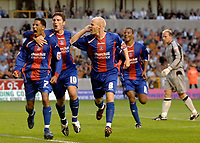 Photo: Glyn Thomas.<br /> Wolverhampton Wanderers v Crystal Palace. Coca Cola Championship. 09/08/2005.<br /> Palace's Jobi McAnuff (L) celebrates equalising for his team with Jonathan Macken (second from L) and Andy Johnson, as Wolves keeper Michael Oakes (R) looks dejected.