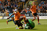 Wolverhampton Wanderers defender Dominic Iorfa clashes with Sheffield Wednesday goalkeeper Joe Wildsmith during the Sky Bet Championship match between Wolverhampton Wanderers and Sheffield Wednesday at Molineux, Wolverhampton, England on 7 May 2016. Photo by Alan Franklin.