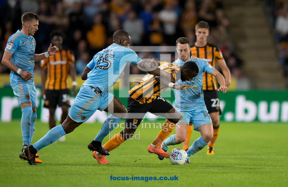Adama Diomande of Hull City (centre) looks to get away from Willy Boly of Wolverhampton Wanderers and Diogo Jota of Wolverhampton Wanderers (right) during the Sky Bet Championship match at the KCOM Stadium, Hull<br /> Picture by Russell Hart/Focus Images Ltd 07791 688 420<br /> 15/08/2017
