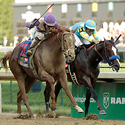 I'll Have Another with Mario Gutierrez up overtakes Bodemeister with Mike Smith up to win the 138th running of the Kentucky Derby at Churchill Downs in Louisville, Ky. Saturday May 5, 2012.  Photo by David Stephenson
