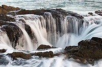 """Not too long ago I was traveling across Oregon Coast on a nature photography trip with an old friend and one of the places he wanted to check out was Thor's Well, located about midway down the state's incredible coastline at a place called Cape Perpetua. <br /> <br /> Formed out of natural volcanic rock (basalt), this wild geologic anomaly was probably formed by a cave beaten into the cliff that eventually collapsed forming this unusual seeming deep hole in the ground but is actually open underwater to the surf. This causes water to explode violently upward through the """"well"""", followed by the foamy water to duck back down into the depths of the earth.<br /> <br /> It was utterly fascinating, even if I did get hit and completely soaked by one of the infamous rogue waves of the Pacific Ocean."""