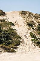 Bruninho sandboarding on the dunes of Campo Bom Beach. Jaguaruna, Santa Catarina, Brazil. / <br /> Bruninho andando de sandboard nas dunas da Praia de Campo Bom. Jaguaruna, Santa Catarina, Brasil.