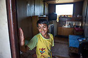 """The son of Juraj standing on the entrance of a container the family lifed in before they joined a pilot project constructing low-cost houses called """"From Shack into a 3E (Ecological and Energy Efficient) House"""",<br /> which was implemented in the village of Rankovce located about 30 km from Kosicein 2013. The pilot project took place in a marginalized Roma community - all the builders were<br /> unemployed Roma living with their families in difficult conditions."""