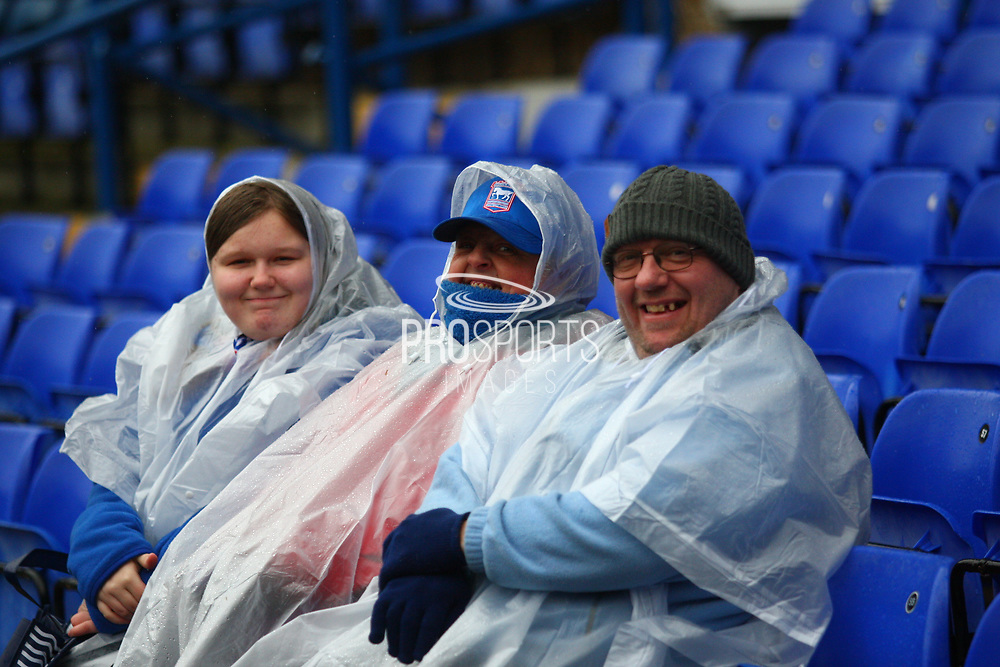 Ipswich fans keep try at a wet stadium during the EFL Sky Bet Championship match between Ipswich Town and Burton Albion at Portman Road, Ipswich, England on 10 February 2018. Picture by John Potts.