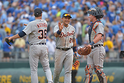 Sep 20, 2014; Kansas City, MO, USA; Detroit Tigers relief pitcher Joe Nathan (36) and catcher James McCann (34) are congratulated by first baseman Miguel Cabrera (24) after the game against the Kansas City Royals at Kauffman Stadium. Detroit won 3-2. Mandatory Credit: Denny Medley-USA TODAY Sports