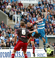 Photo: Kevin Poolman.<br />Reading v Stoke City. Coca Cola Championship. 17/04/2006. Reading's Stephen Hunt and Stoke's Carl Dickinson go up for the ball.