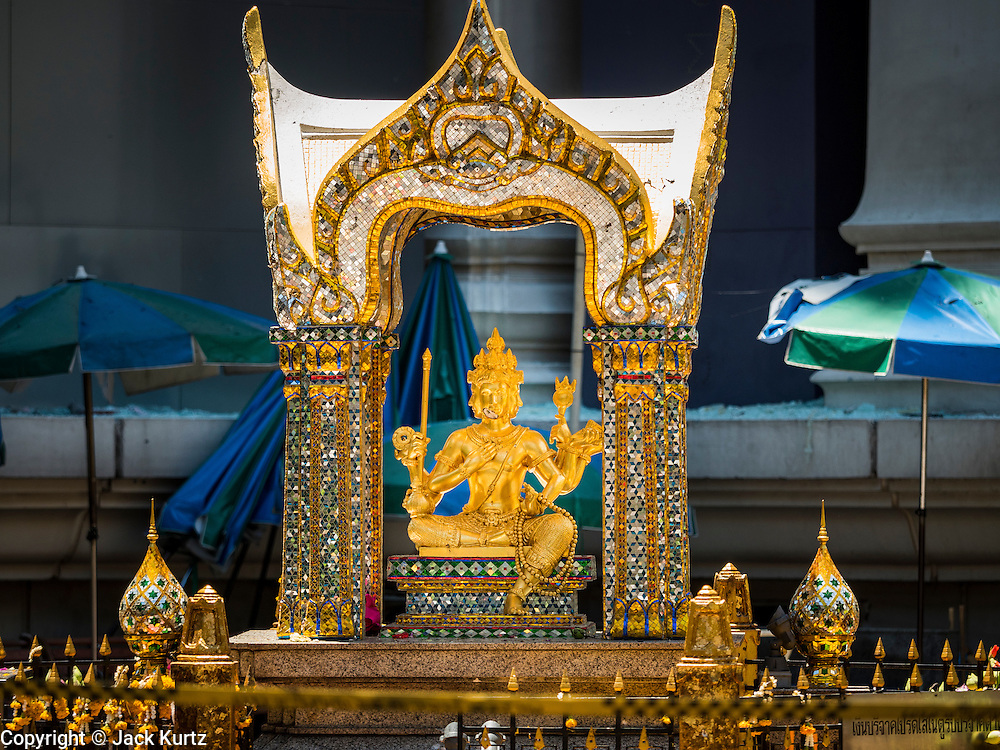 18 AUGUST 2015 - BANGKOK, THAILAND: The damaged Four Faced Brahma statue at Erawan Shrine Tuesday. An explosion at Erawan Shrine, a popular tourist attraction and important religious shrine in the heart of the Bangkok shopping district, killed at least 20 people and injured more than 120 others, including foreign tourists, during the Monday evening rush hour. Twelve of the dead were killed at the scene. Thai police said an Improvised Explosive Device (IED) was detonated at 18.55. Police said the bomb was made of more than six pounds of explosives stuffed in a pipe and wrapped with white cloth. Its destructive radius was estimated at 100 meters.    PHOTO BY JACK KURTZ