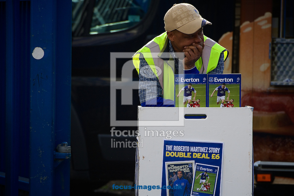 General view of the exterior of the stadium showing programme seller ahead of the Barclays Premier League match at Goodison Park, Liverpool<br /> Picture by Ian Wadkins/Focus Images Ltd +44 7877 568959<br /> 16/04/2014