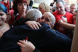 © Licensed to London News Pictures. 19/08/2016. Sheffield, UK. Jeremy Corbyn hugs a tearful supporter at a campaign rally in Sheffield, South Yorkshire, during the 2016 Labour leadership election. Photo credit : Ian Hinchliffe/LNP