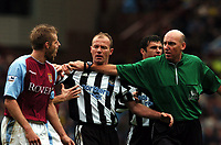 Fotball<br /> Premier League 2003/04<br /> Aston Villa v Newcastle<br /> Birmingham<br /> 18. april 2004<br /> Foto: Digitalsport<br /> Norway Only<br /> <br /> OLOF MELLBERG ASTON VILLA/ALAN SHEARER NEWCASTLE UNITED TEMPERS FLARE AS REFEREE B KNIGHT TRIES TO KEEP CONTROL