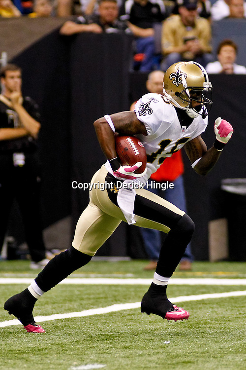 Oct 24, 2010; New Orleans, LA, USA; New Orleans Saints wide receiver Courtney Roby (15) runs with the ball during the first half against the Cleveland Browns at the Louisiana Superdome. Mandatory Credit: Derick E. Hingle