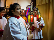 30 MARCH 2018 - BANGKOK, THAILAND: Altar attendants in line during the Stations of the Cross during Good Friday observances at Santa Cruz Church in the Thonburi section of Bangkok. Santa Cruz Church is more than 350 years old and is one of the oldest Catholic churches in Thailand. Good Friday is the day that most Christians observe as the crucifixion of Jesus Christ. Thailand has a small Catholic community.        PHOTO BY JACK KURTZ