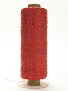 spool with a red thread
