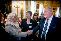 Image ©Licensed to i-Images Picture Agency. 08/07/2014. London, United Kingdom. Eric Pickles  meets Mejra Duguz  a mother of Srebrenica at the Srebrenica Memorial Reception at Lancaster House. Picture by Andrew Parsons / i-Images